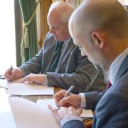 Treasurer Duane A. Davidson (left) and Deputy Treasurer of Debt Management Jason Richter (right).